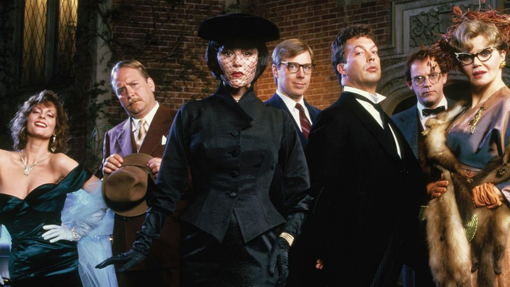 The cast of Clue left to right: Lesley Ann Warren, Martin Mull, Madeline Kahn, Michael McKean, Tim Curry, Christopher Lloyd, and Eileen Brennan