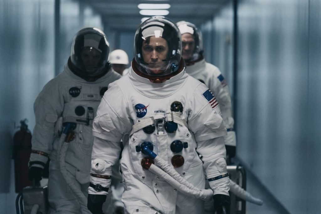 Ryan Gosling, Cory Stoll and Lukas Hass suited upas the Apollo 11 crew