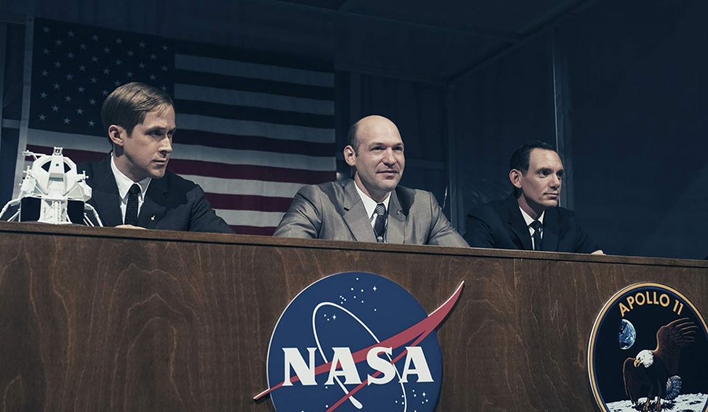 Ryan Gosling as Lance Armstrong (left), Cory Stoll as Buzz Aldrin (center) and Lukas Haas as Michael Collins (right)
