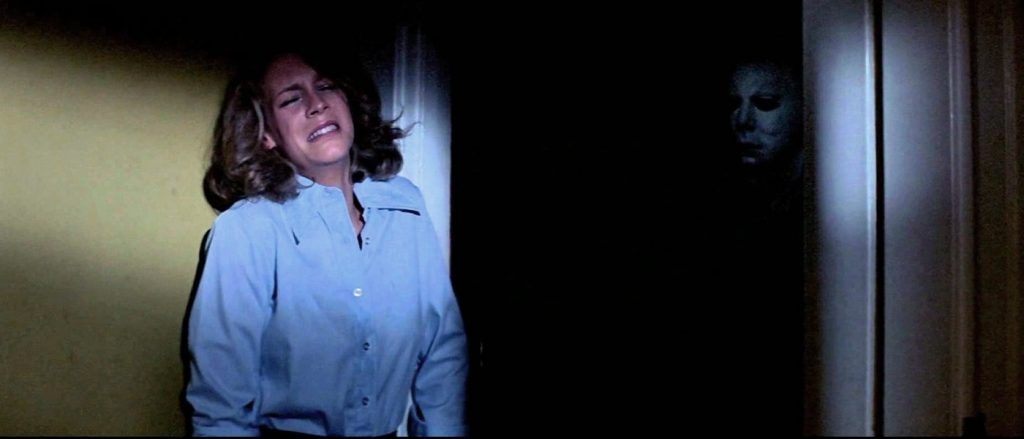 Jamie Lee Curtis as Laurie(left) and Tony Moran as Michael Myers (right)