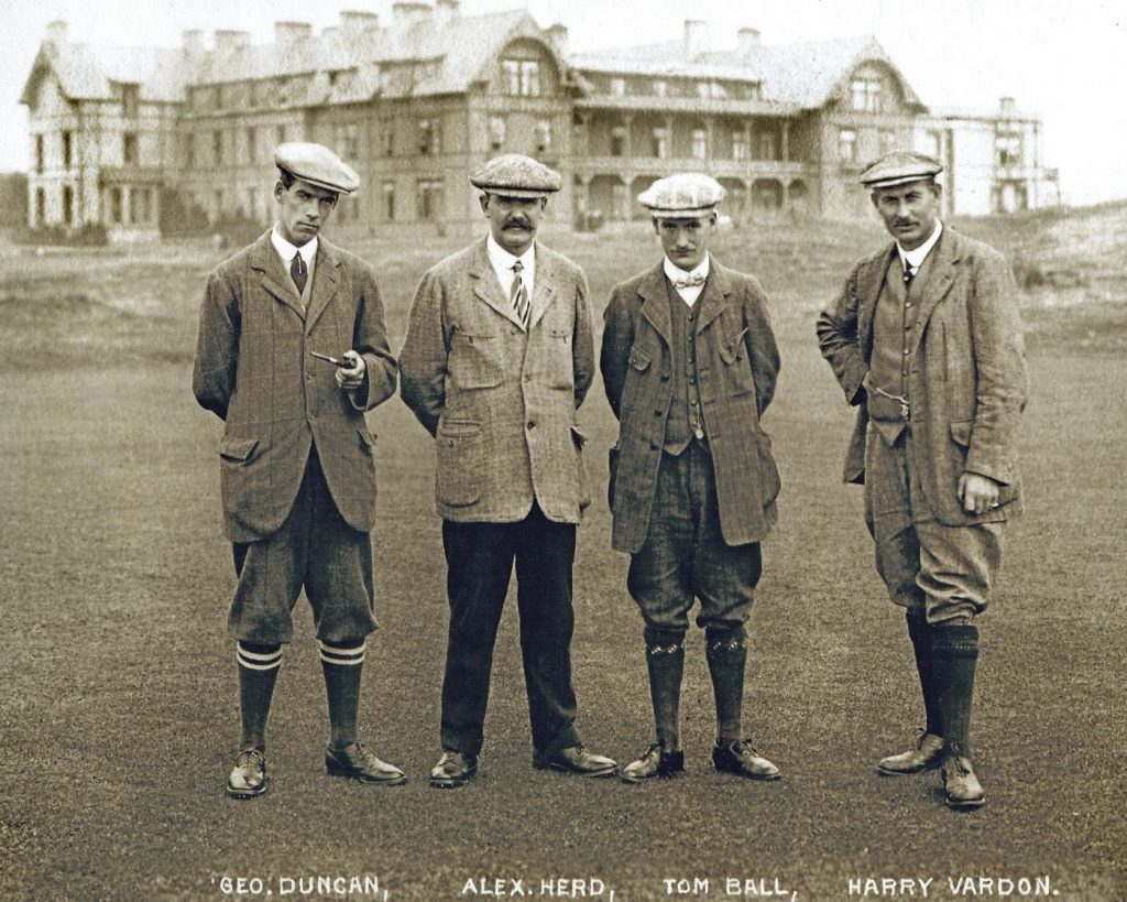 four men in golf caps and knickers