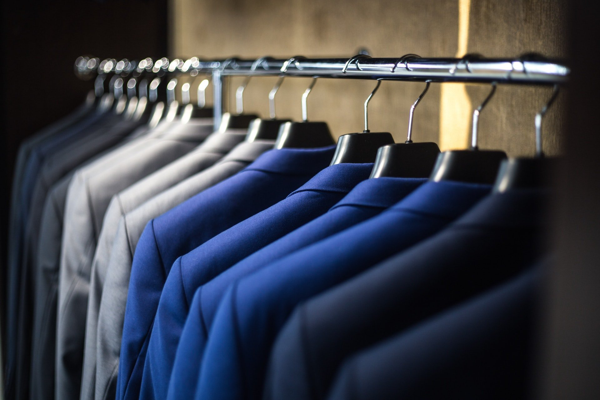 suits on clothes rack