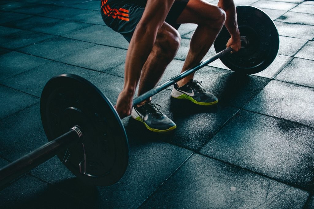 Man strength training by lifting weights